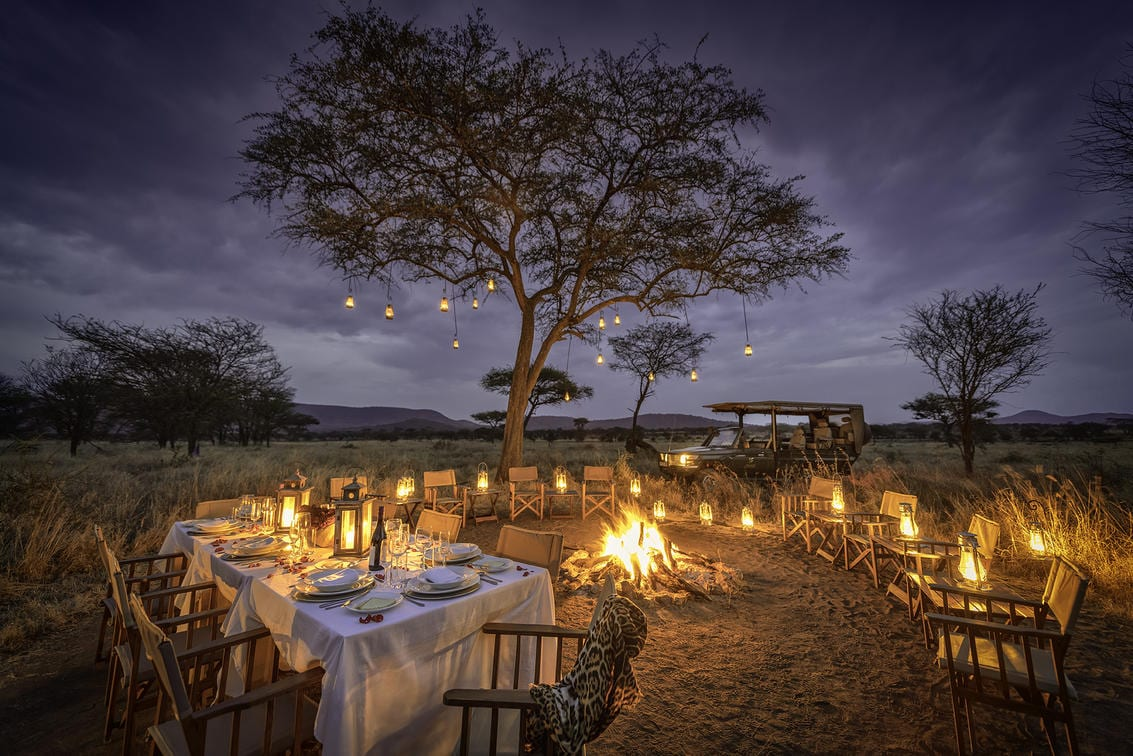 Nimali Central Serengeti dining by the fire